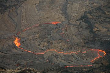 The lava lake at dusk and an initial stage of crust overturn in the center.  (Photo: Tom Pfeiffer)