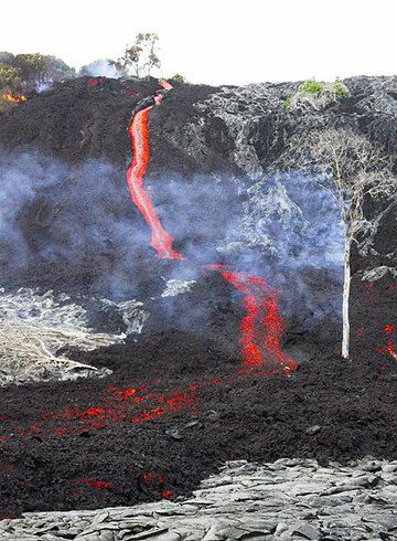 The leading edge of an 'a'a lava flow descends Pulama Pali, being fed from the Peace Day Fissure on Pu'u 'O'o vent on K?lauea volcano on December 4, 2011. (Photo: Philip Ong)