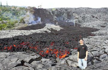 Philip stands by the leading edge of an 'a'a lava flow at the base of Pulama Pali, being fed from the Peace Day Fissure on Pu'u 'O'o vent on K?lauea volcano on December 4, 2011. (Photo: Philip Ong)