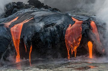 Lava pours constantly - most is used to create black sand. (Photo: Tom Pfeiffer)