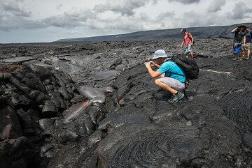Hikers enjoy getting personal with real, red hot lava! (Photo: Tom Pfeiffer)
