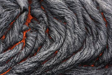 Active lava breakouts were present about 2 km inland in the coastal flat in mid September 2016. Although the sea entry was the main attraction, a short hike to these flows was a welcome break.  (Photo: Tom Pfeiffer)