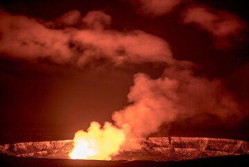 Brightly illuminated Halema'uma'u crater at night. (c)