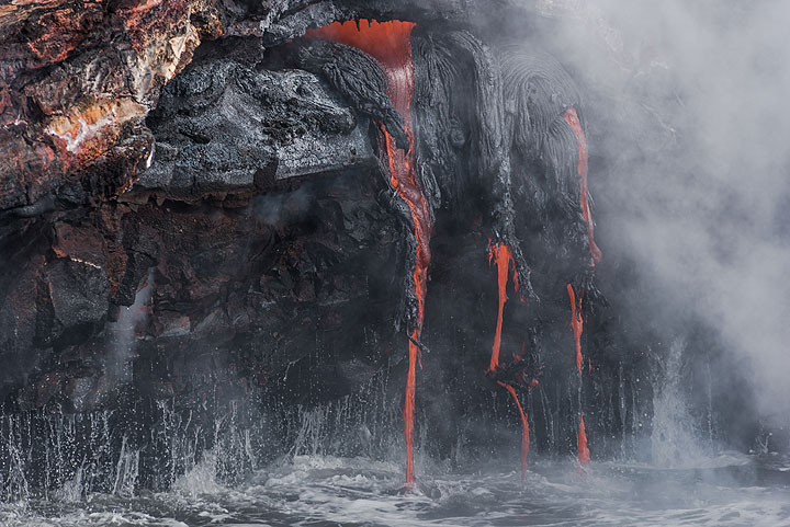 A small exposed active lava tube (Photo: Tom Pfeiffer)