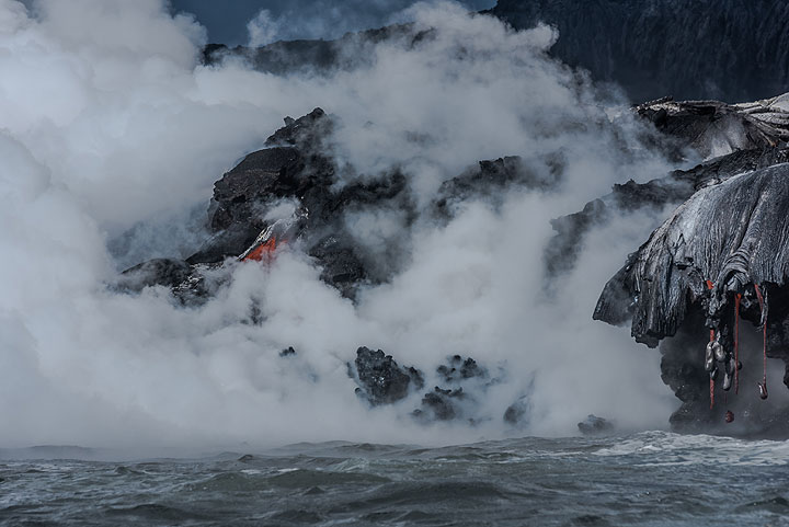 Lava and sea fighting each other. (Photo: Tom Pfeiffer)