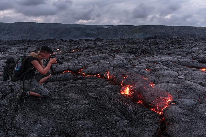 Kat taking pictures of an active lava flow. (Photo: Tom Pfeiffer)