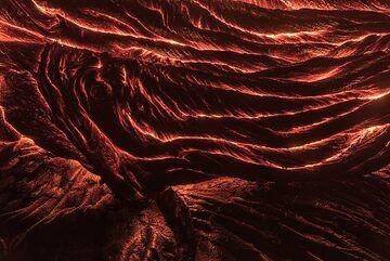 Active lava creeping over older, similar ropy lava. (Photo: Tom Pfeiffer)