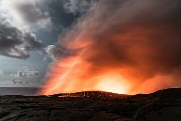 The steam plume from the Kamokuna ocean entry is illuminated by both the lava and the moon. (Photo: Tom Pfeiffer)