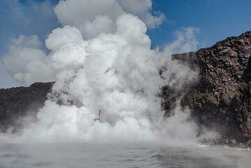 The surface water around the entry area is near-boiling point and steam rises everywhere. (Photo: Tom Pfeiffer)