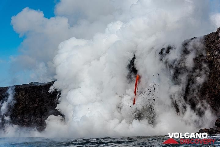 Most of the time, the lava hose is hidden in thick steam, but occasionally, it comes into sight. (Photo: Tom Pfeiffer)