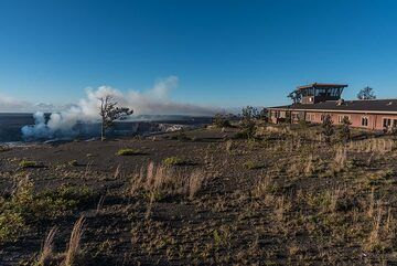 The main building of the USGS Hawaiian Volcano Observatory (HVO) with the watch tower standing on the rim of Kilauea caldera. (Photo: Tom Pfeiffer)