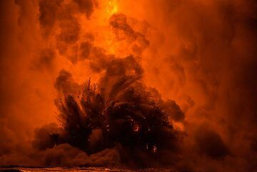 The lava hose can be barely seen behind the steam and explosion. (Photo: Tom Pfeiffer)