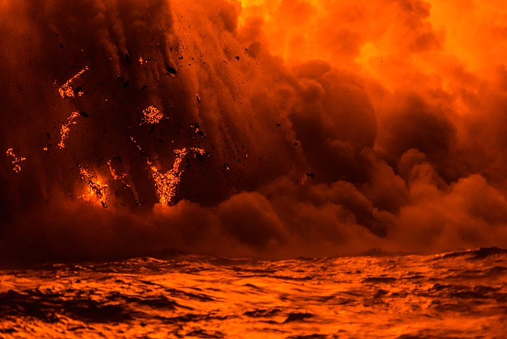 Larger, bizarrely shaped lava fragments about to fall back into the water (Photo: Tom Pfeiffer)
