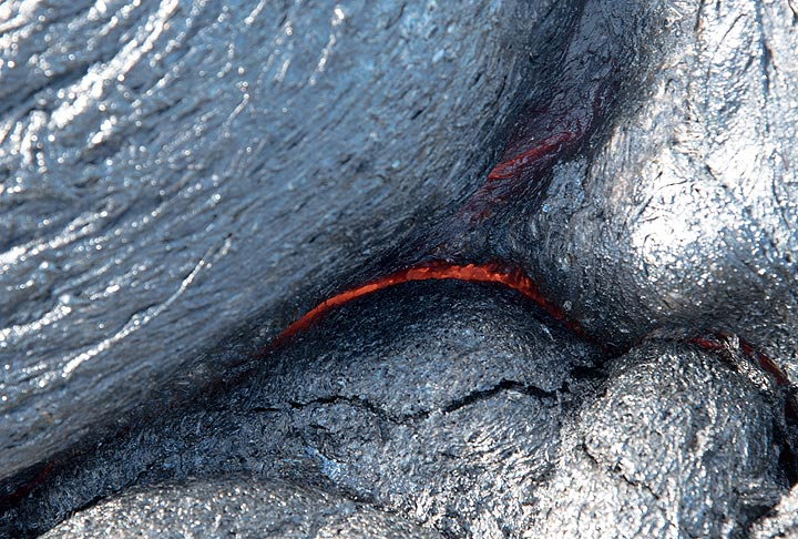 A silvery glassy skin has formed above a fresh lava toe that is just about 2 minutes old. (Photo: Tom Pfeiffer)