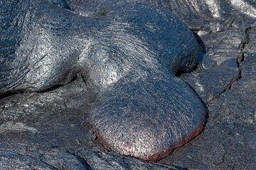 In sunlight, the lava glow is almost eclipsed by the reflection of the quickly forming, silvery skin. (Photo: Tom Pfeiffer)