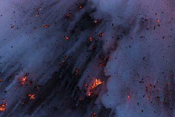 Bluish light of dawn and glowing lava fragments. (Photo: Tom Pfeiffer)