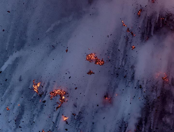 Lava bomb trails at dawn. (Photo: Tom Pfeiffer)
