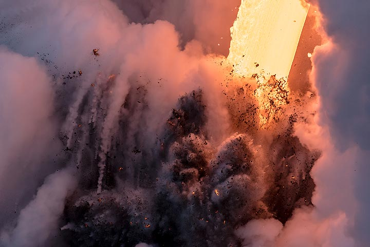An explosion sends multiple jets of dense mixtures of water and lava fragments above the waves. (Photo: Tom Pfeiffer)