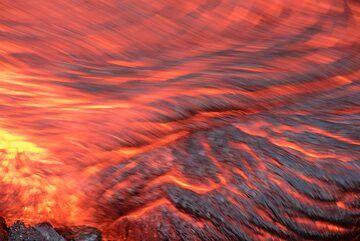 "Orange ""red hot"" lava in motion (Photo: Tom Pfeiffer)"