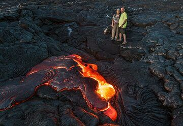Leland and Mimi who found this large breakout of surface lava. (Photo: Tom Pfeiffer)