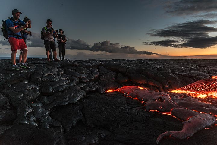 Another group of tourists gathers at a particularly active lava breakout. (Photo: Tom Pfeiffer)