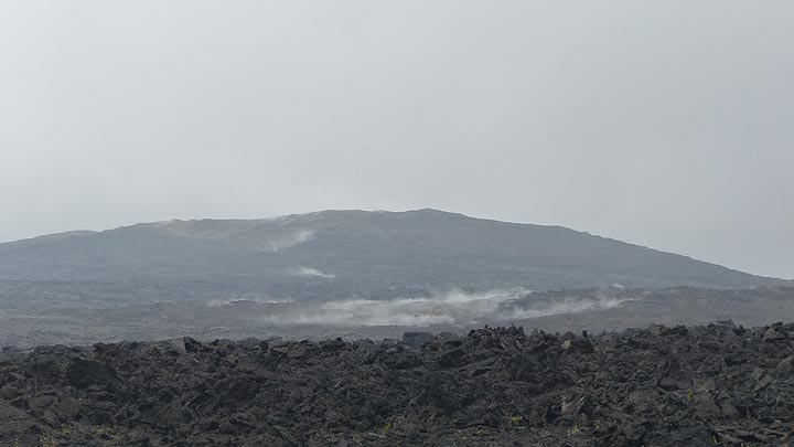 Day 2: Close up of the distant lava field of Pu´u O´o and the steam that rises up from around the still hot lava flows around it (Photo: Steven Van den Berge / Lana Van Heghe)