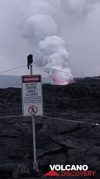 Day 2: The National Park authorities marked off a safe perimeter from where to watch where the lava flows into the ocean, creating a billowing steam plume (Photo: Steven Van den Berge / Lana Van Heghe)