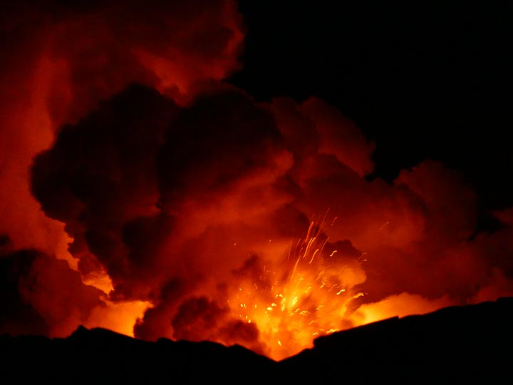 Day 2: The interaction between over a 1000 degrees C hot lava and ocean water is an explosive one, at times we can see small fragments of lava being thrown around and through the steam clouds. (Photo: Ingrid Smet)