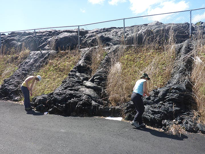 Day 5: Studying the ropey texture of the pahoehoe lava that burn through the metal wire fence and rand down the small slope (Photo: Ingrid Smet)