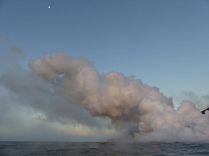 Day 5: The moon above the large steam clouds that billow up from the lava ocean entry (Photo: Ingrid Smet)