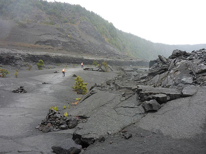 Day 6: View from the crater floor across to the base of the inner crater walls where you see horizontal layers of lava subsidence terraces which formed when some of the lava drained back into the vent, leaving ´bathtub ring´ like reminders of its highest level. (Photo: Ingrid Smet)