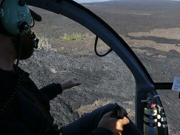Extension day 3: Flying over the lava fields our pilot tries to spot the freshest silvery coloured lava flows in the hopes of seeing some fresh overland breakouts (Photo: Ingrid Smet)