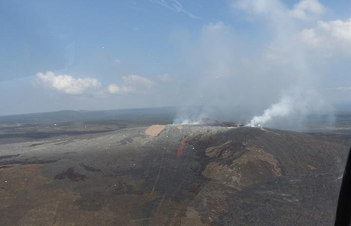 Extension day 3: View towards the lava shield of Pu´u O´o where steam plumes rise up from the different active craters and vents (Photo: Steven Van den Berge / Lana Van Heghe)