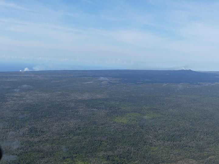 Extension day 3: View towards the since 1983 ongoing eruption in the East Rift Zone, with to the right the lava shield with Pu´u O´o crater from where lava flows travel underground Kamukona ocean entry marked by the steam plume (left) (Photo: Ingrid Smet)