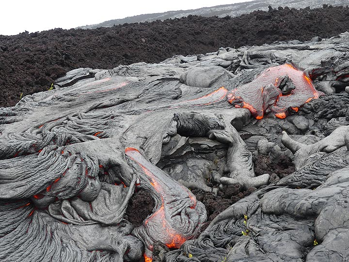 Multiple lateral pahoehoe lava flows emerging from the main lava flow front (Photo: Ingrid Smet)