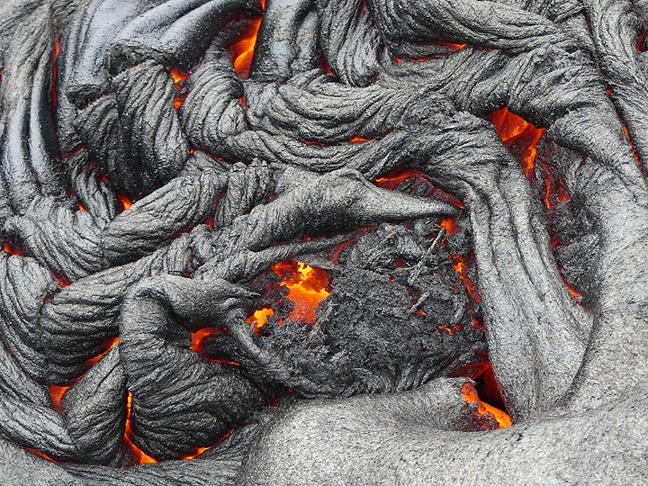 Detail of freshly formed silvery crust and its red hot liquid lava interior (Photo: Ingrid Smet)
