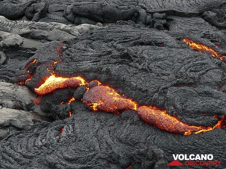 Lava oozing out from the inflating crust of the flow front. (Photo: Ingrid Smet)