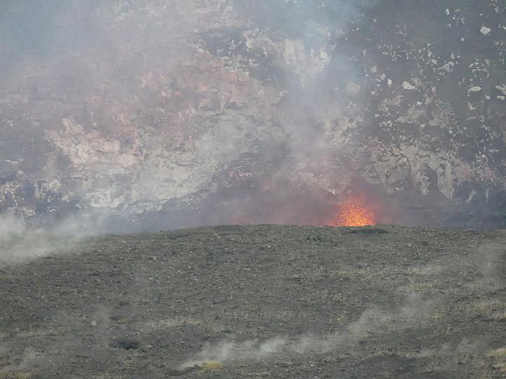 On the evening of the 17th of March 2018 one could see lava spattering above the rim of Haleama'uma'u crater (Photo: Ingrid Smet)