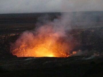 A small VolcanoDiscovery group was on a 7 days volcano adventure during the 10th anniversary of a continuous active lava lake inside Halema'uma'u crater in Kilauea's summit caldera. Since the reappearance of lava inside Halema'uma'u crater on 19 March 2008 the level of the active lava lake has been fluctuating a lot and is sometimes visible from the Jagger Museum lookout some 1 km away from the vent. There was also lava spattering from gas bubbles exploding through the surface of the lake in mid March 2018. (Photo: Ingrid Smet)