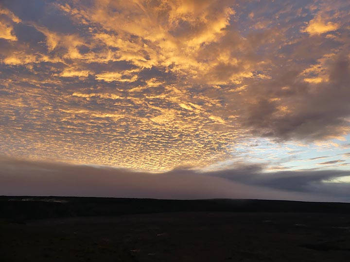 A cloudy sky makes for a dramatic sunrise on the 10th anniversary of the current activity inside Halema'uma'u crater (Photo: Ingrid Smet)
