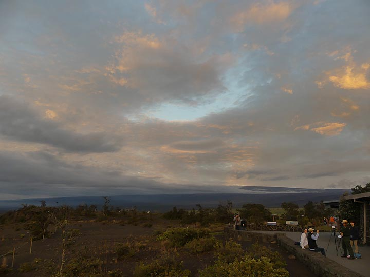 Journalists and Hawaii Volcanoes National Park Rangers are setting up a live stream interview for the occasion of 10 years lava lake in Halema'uma'u, with the cloud covered Mauna Loa shield in the background (Photo: Ingrid Smet)