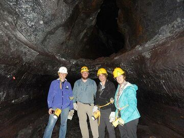 Group photo in the Kazumura caves in front of a double, or tube in tube, lava cave (Photo: Ingrid Smet)