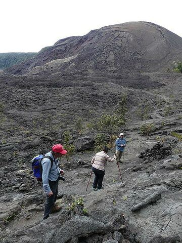 We make our way along the edge of the now cooled lava field towards the impressive 1959 scoria cone (Photo: Ingrid Smet)