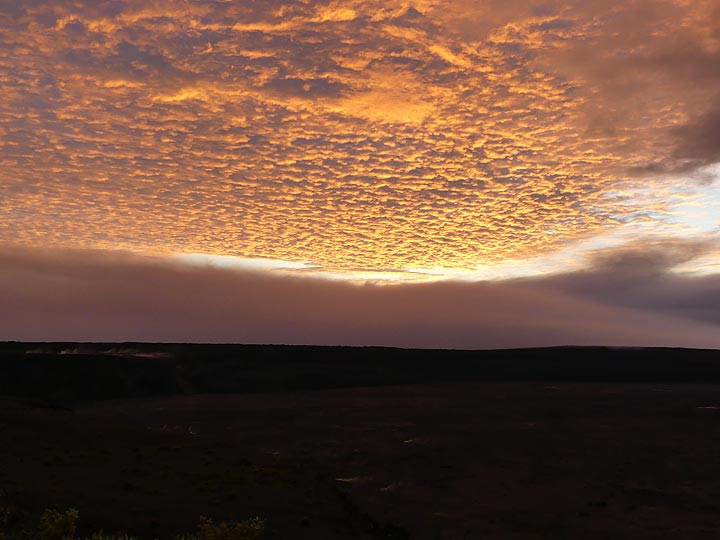 Sunrise on the morning of the 10 year anniversary of the return of a lava lake in Halema'uma'u crater is quite impressive! (Photo: Ingrid Smet)