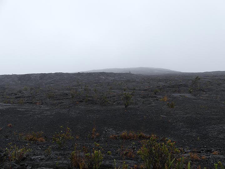The small shield created during the Mauna Ulu eruption around the main vent is visible on the horizon in the background, slightly to the left in the foreground is the perched lava lake that formed in the later stages of this eruption (Photo: Ingrid Smet)
