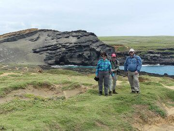 Our group in front of the green sands beach scoria cone and bay (Photo: Ingrid Smet)