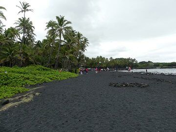 Black Sand Beach is located to the northeast of Green Sand Beach and is entirely constructed of grains of black lava (Photo: Ingrid Smet)