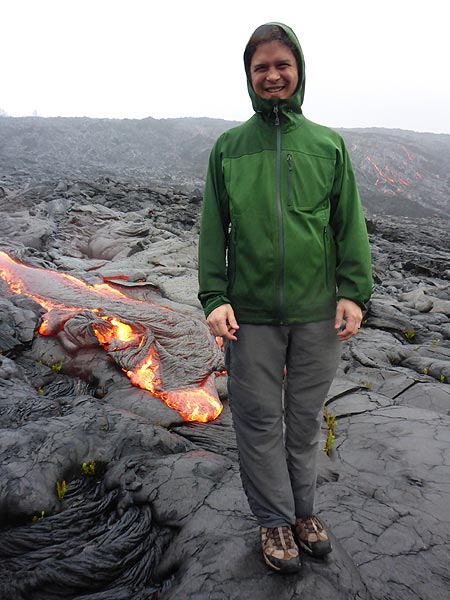 Philip Ong, our experienced active lava flows guide, trying to dry up a little close to the active lava flows (Photo: Ingrid Smet)