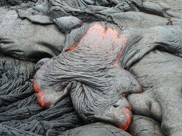Active pahoehoe lava front flowing down older lava flows and forming the typical ropey crust (Photo: Ingrid Smet)