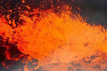 Degassing lava fountain at a lava pond of Kilauea's Puu Oo crater (Photo: Tom Pfeiffer)
